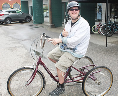 Adam Lord tries out of one of two trikes that was stolen but has now been returned to Kindale.
