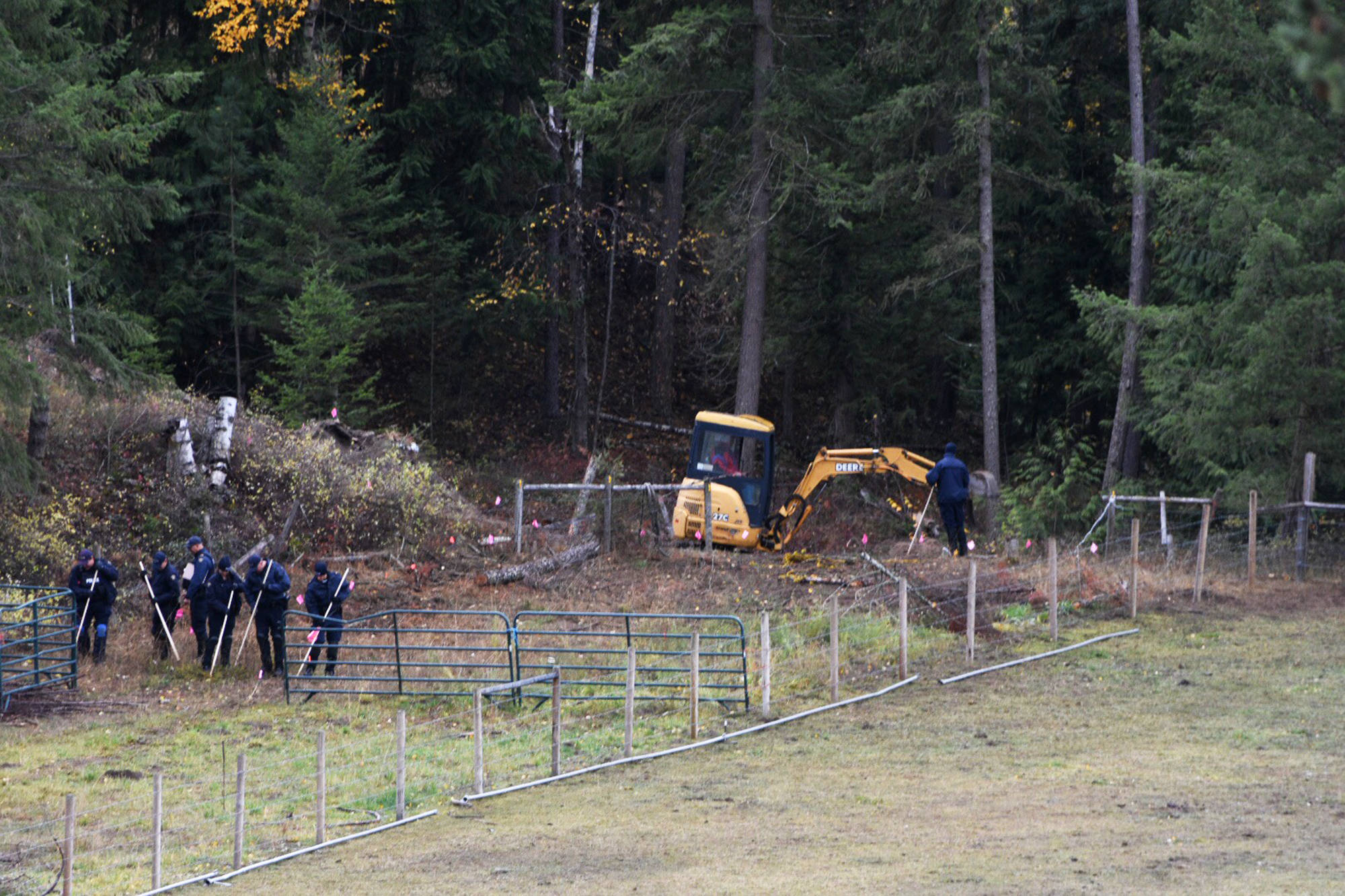 RCMP officers search the Sagmoen farm where the remains of 18-year-old Tracy Genereaux would later be discovered. -image credit: Jim Elliot/Salmon Arm Observer