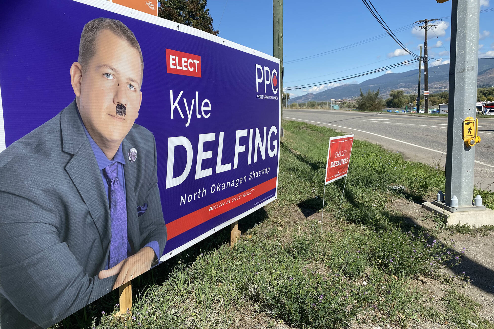 Several of North Okanagan-Shuswap PPC candidate Kyle Delfing's campaign signs have been targeted by vandals spraying 'fascist' or drawing toothbrush moustaches on. (Caitlin Clow - Vernon Morning Star)